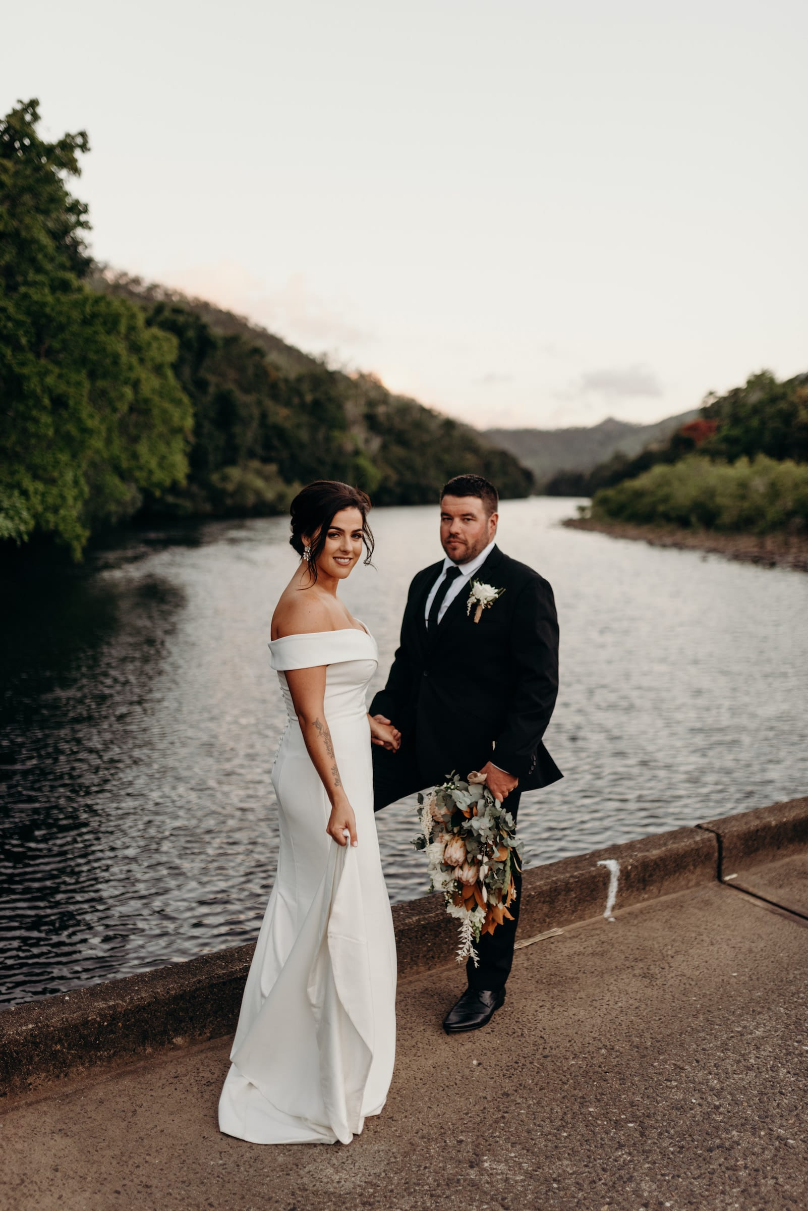 Cairns Wedding photography, Couple standing on a bridge