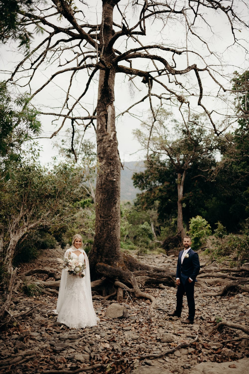 Cairns wedding couple infront of tree