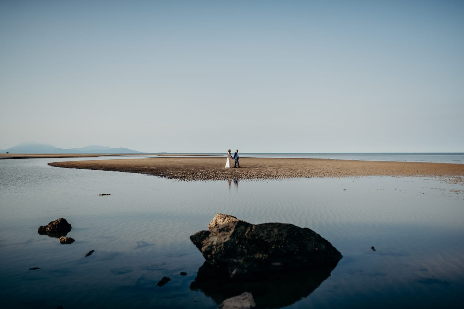 Port Douglas wedding couple walking on the low tide sand
