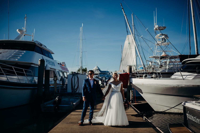 couple holding hands port douglas