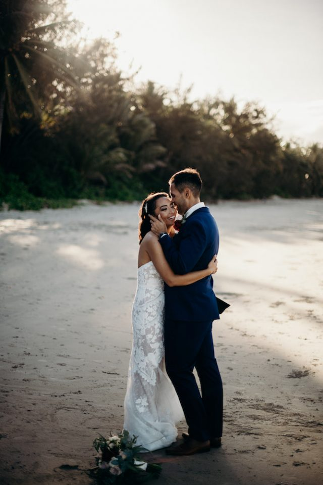 couple on beach port douglas