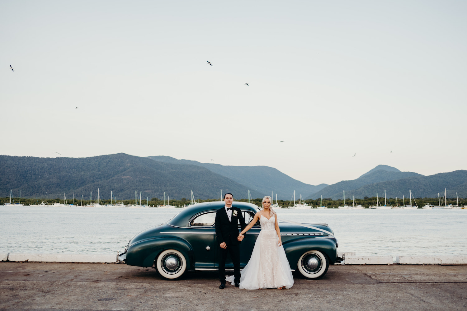 cairns wedding couple holding hands vintage car harbour