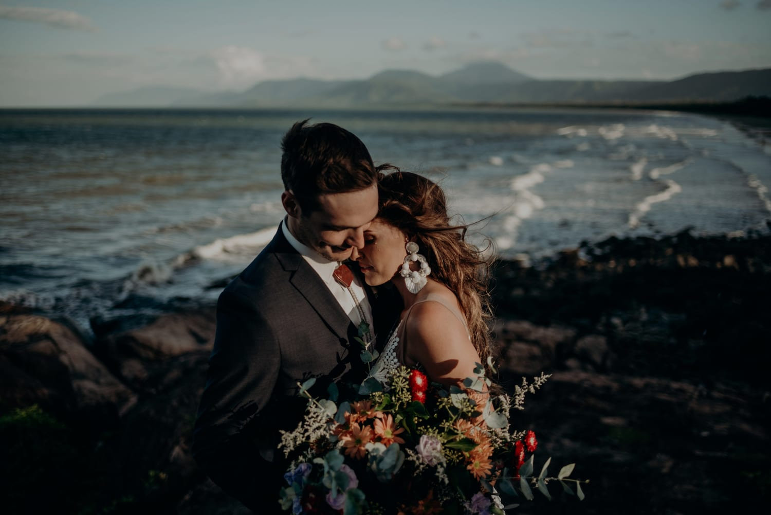 newlyweds embracing port douglas beach