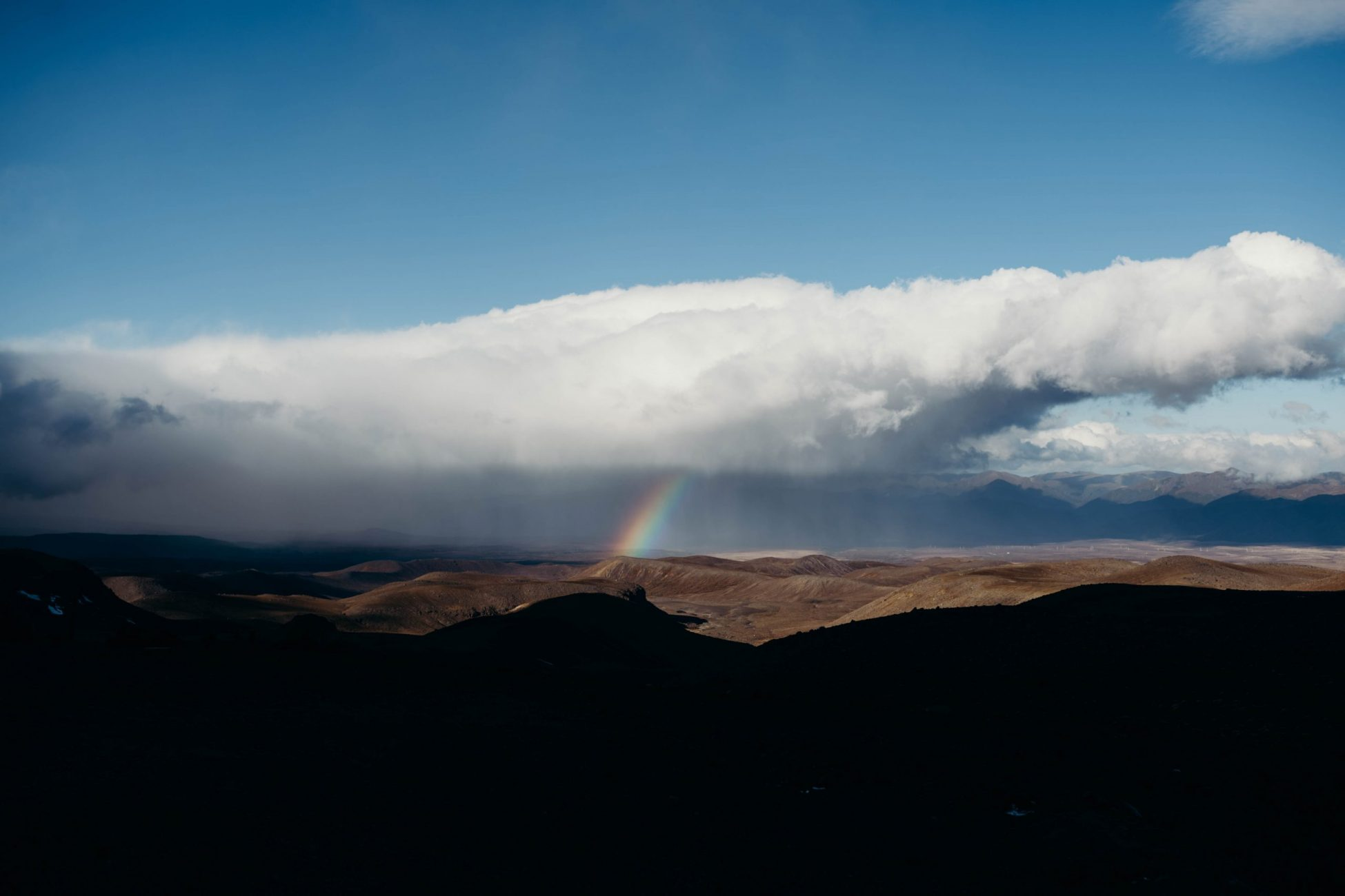 Rainbow over mountains in New Zealand